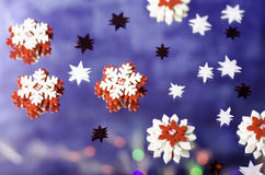 Christmas snowflakes and little stars. Christmas snowflakes and little stars on a blue background Royalty Free Stock Photo