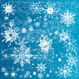 Christmas snowflakes over blue background Royalty Free Stock Photography