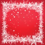 Christmas snowflakes on red background. Royalty Free Stock Image
