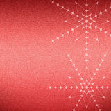 Christmas snowflakes on a red jeans texture Royalty Free Stock Photos