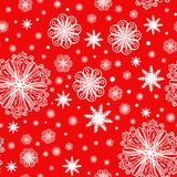 Christmas snowflakes on red seamless pattern Royalty Free Stock Images