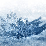 Christmas snowflakes on snow Royalty Free Stock Photos