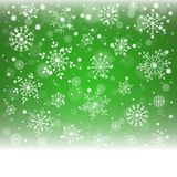 Christmas snowflakes and snowdrift on green background. Vector illustration Stock Photos