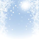 Christmas snowflakes and sun on blue background. Stock Images