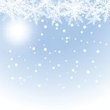 Christmas snowflakes and sun on blue background. Royalty Free Stock Photo