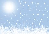 Christmas snowflakes and sun on blue background. Stock Image
