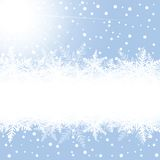 Christmas snowflakes and sun on blue background. Royalty Free Stock Photos