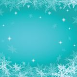 Christmas snowflakes on turquoise background. Stock Image