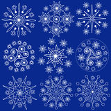 Christmas Snowflakes (Vector). Nine vector decorative white snowflakes on a dark blue background Stock Photography