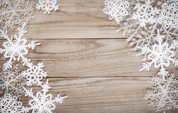 Christmas snowflakes on wooden background Stock Images