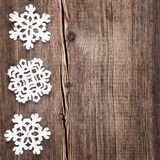Christmas snowflakes on wooden background Royalty Free Stock Photos