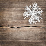 Christmas snowflakes on wooden background Stock Photography