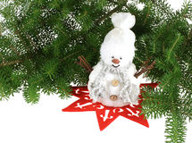 Christmas snowman. Snowman on red star and pine branches - all isolated over white background royalty free stock photography