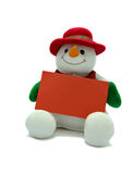 Christmas snowman. Cuddly snowman holding a blank red card for your own message Stock Photography