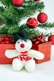 Christmas Snowman. Cuddly christmas snowman with christmas tree and presents Royalty Free Stock Photos