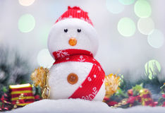 Christmas Snowman. With light on the background Stock Photography