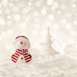 Christmas snowman. Christmas background with snowman, christmas tree and snow Stock Image