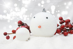 Christmas snowman bauble background. Christmas snowman bauble nestled in snow Royalty Free Stock Photography