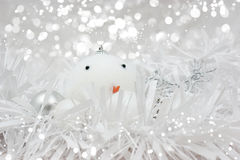 Christmas snowman bauble in tinsel Stock Photos