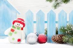 Christmas snowman and bauble toys and fir tree. Christmas snowman toys, baubles and fir tree branch. Xmas decor Stock Photo