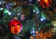 Christmas Snowman Baubles. Two Christmas baubles, in color, hanging on a  Christmas tree Stock Photography