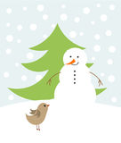 Christmas snowman and bird Royalty Free Stock Photography
