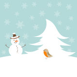 Christmas snowman and bird Royalty Free Stock Images