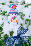 Christmas Snowman and blue bow Royalty Free Stock Images