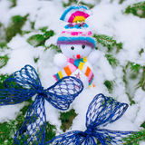 Christmas Snowman and blue bow Royalty Free Stock Photos