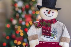Christmas Snowman on Blurred Light Background Stock Images