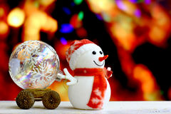 Christmas Snowman on bokeh background.