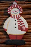 Snowman on cinnamon background. Christmas snowman on cinnamon background Royalty Free Stock Photo