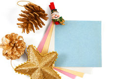Christmas snowman clothespin holding note paper and golden pine Royalty Free Stock Photo