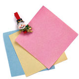 Christmas snowman clothespin holding note paper isolated Stock Images