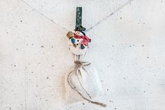 Christmas snowman clothespin holding sack Royalty Free Stock Image