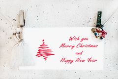 Christmas snowman clothespines holding Christmas greeting card Stock Photography