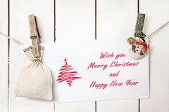 Free Christmas Snowman Clothespines HoldingChristmas Greeting Card Royalty Free Stock Photo - 47632205