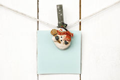 Christmas snowman clothespins holding blank note paper Royalty Free Stock Photo
