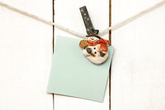 Christmas snowman clothespins holding blank note paper Royalty Free Stock Photos