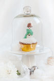 Christmas snowman cupcake under glass dome Stock Photos