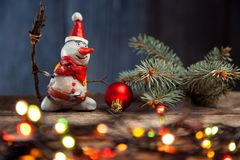 Christmas snowman decoration against the backdrop illumination a. Nd fir tree Stock Photography