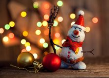 Christmas snowman decoration against the backdrop illumination a. Nd fir tree Royalty Free Stock Photo