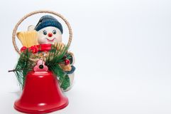 Christmas snowman decoration with red bells. Christmas snowman decoration with red bells, isolated on white background Royalty Free Stock Images