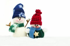 Christmas snowman decorations in fresh snow over white Royalty Free Stock Photo