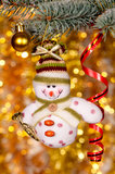 Christmas snowman on fir tree branch Royalty Free Stock Images