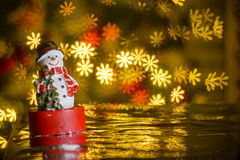 Christmas snowman and flower shaped lights in background Royalty Free Stock Images