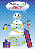 Christmas snowman. Funny cartoon vector illustration of snowman with tree light garlands, holding Christmas ornaments and wrapped gifts that are lying beside him Royalty Free Stock Photography