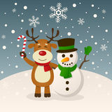 Christmas Snowman and Funny Reindeer. A cartoon Christmas scene with a cute snowman greeting and a funny reindeer holding a candy cane, in a snowy scene. Eps Stock Images