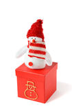 Christmas snowman with a gift Royalty Free Stock Image