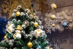 Christmas snowman, gift box,baubles decoration on snowing Christ. Mas tree - close-up Royalty Free Stock Image